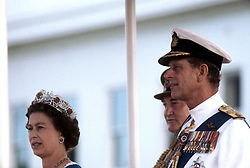 Queen Elizabeth II, and the Duke of Edinburgh watch a march past during a parade of the armed forces after they had attended the State Opening of Parliament in Canberra.