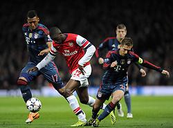 Arsenal's Yaya Sanogo battles for the ball with Bayern Munich's Philipp Lahm and Bayern Munich's Jerome Boateng - Photo mandatory by-line: Joe Meredith/JMP - Tel: Mobile: 07966 386802 19/02/2014 - SPORT - FOOTBALL - London - Emirates Stadium - Arsenal v Bayern Munich - Champions League - Last 16 - First Leg
