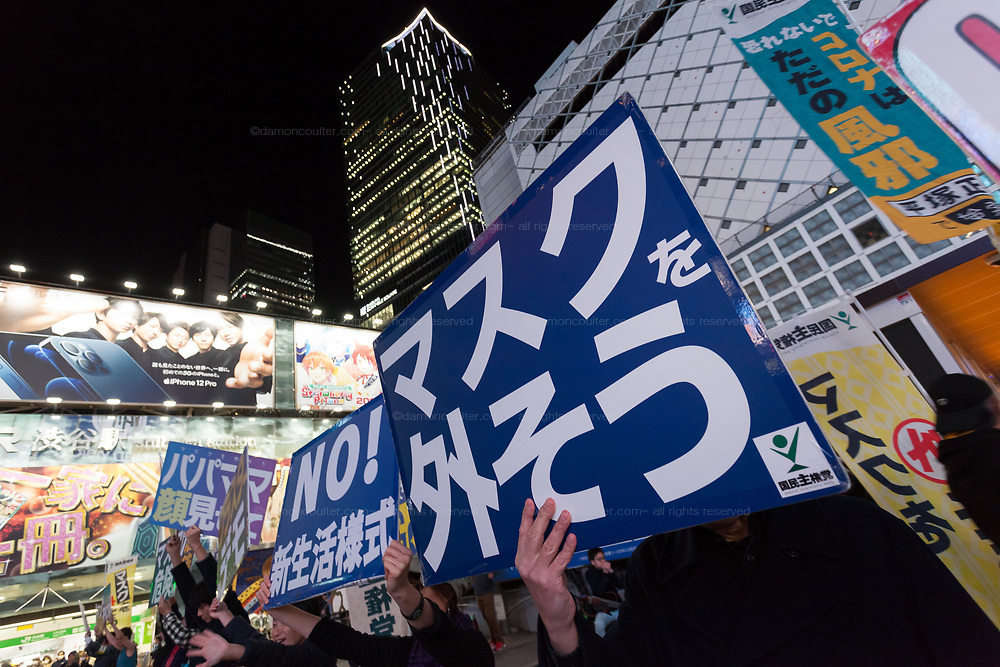 "Anti-mask protesters in front of Shibuya Station, Tokyo, Japan. Saturday November 21st 2020. Many protestor support YouTuber and leader of the Popular Sovereignty Party Masayuki Hiratsuka, who unsuccessful campaigned in the July Tokyo Gubernatorial Election. withnthe slogan ""Coronavirus is just a cold"". The group hold ""cluster festivals"" on trains and around Tokyo oposing any government action to combat the Pandemic. Photo Damon Coulter/AFLO"