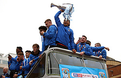 Coventry City's Maime Biamou (centre) lifts the trophy during the Sky Bet League Two promotion parade in Coventry.