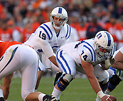 CHARLOTTESVILLE, VA- NOVEMBER 12: Guard Dave Harding #74  hikes the ball to quarterback Sean Renfree #19 of the Duke Blue Devils during the game against the Virginia Cavaliers on November 12, 2011 at Scott Stadium in Charlottesville, Virginia. Virginia defeated Duke 31-21. (Photo by Andrew Shurtleff/Getty Images) *** Local Caption *** Dave Harding;Sean Renfree