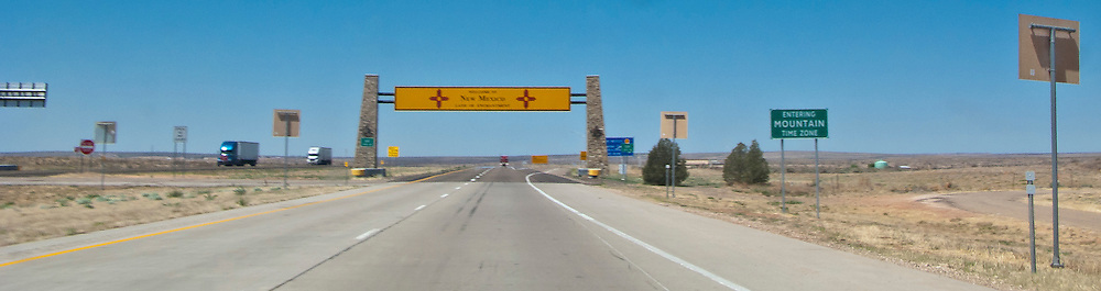 sign announcing the New Mexico state line and Mountain Time Zone on Interstate 20  panorama