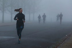 © Licensed to London News Pictures. 07/12/2020. London, UK. Runners in dense fog in Finsbury Park, north London. Freezing cold and foggy weather is forecast across many parts of the UK. Photo credit: Dinendra Haria/LNP