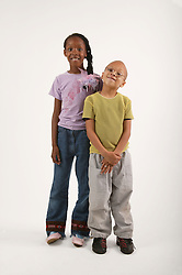 Portrait of young boy with older girl,