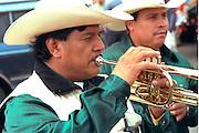 Musician age 45 at Cinco de Mayo parade.  St Paul Minnesota USA