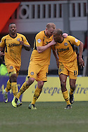 Chris Zebroski of Newport County (right) celebrates after scoring his side's injury time equaliser with Lee Minshull. Skybet football league 2 match, Newport county v Scunthorpe Utd at Rodney Parade in Newport, South Wales on Saturday 1st March 2014.<br /> pic by Mark Hawkins, Andrew Orchard sports photography.