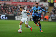 Dele Alli of Tottenham Hotspur ® challenges Jefferson Montero of Swansea city. Barclays premier league match, Swansea city v Tottenham Hotspur at the Liberty Stadium in Swansea, South Wales on Sunday 4th October 2015.<br /> pic by  Andrew Orchard, Andrew Orchard sports photography.