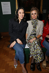(left to right) Eva Chen and Laura Bailey on the front row during the Erdem Autumn/Winter 2019 London Fashion Week show at The National Portrait Gallery, London.