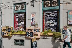THEMENBILD - die farbenfrohe Fassade mit Blumen und bunten Schilder eines Cafés lädt zum Verweilen ein, aufgenommen am 14. August 2019 in Rijeka, Kroatien // The colorful facade with flowers and colorful signs of a café invites you to linger, pictured in Rijeka, Croatia on 2019/08/14. EXPA Pictures © 2019, PhotoCredit: EXPA/Stefanie Oberhauser