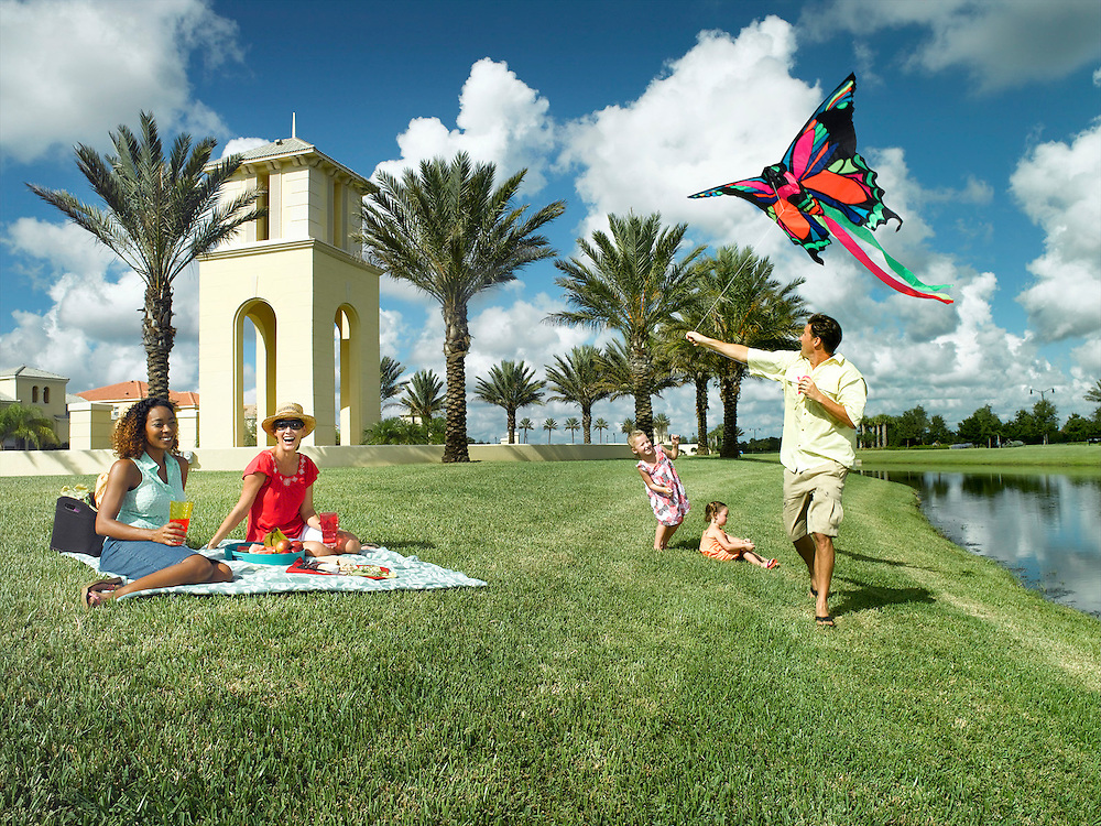 Lifestyle family picnic and kite flying