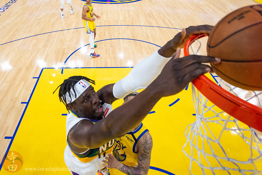 February 23, 2020; San Francisco, California, USA; New Orleans Pelicans guard Jrue Holiday (11) dunks the basketball during the second half against the Golden State Warriors at Chase Center.