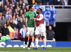 Brighton & Hove Albion's Lewis Dunk and Arsenal's Alexandre Lacazette square up