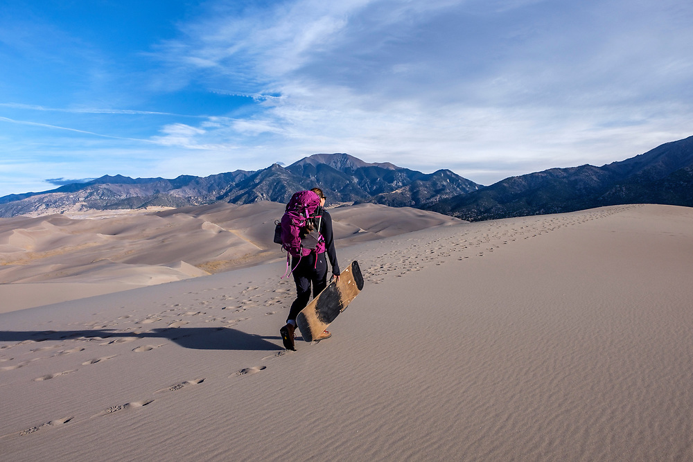 It's a hard climb up the dunes with food and camping gear (and a sand sled!).