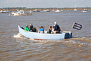 Small ferry boat crossing River Deben between Bawdsey Quay and Felixstowe Ferry, Suffolk, England, UK