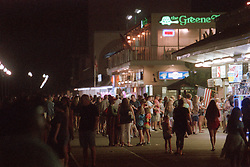 Visitors to the boardwalk in Rehoboth Beach, Del. mill around the storefronts on a late summer night, Tuesday, Aug. 20, 2019. (Photo by D. Ross Cameron)