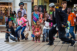 """Lavon Patterson """"Invincible"""" lead a dance workshop at Tutu Park Mall.  Dancers from Invicible, a Michael Jackson tribute, will perform at Reichhold Center for the Arts Saturday at 7pm.  Tutu Park Mall.  1 November 2013.  © Aisha-Zakiya Boyd"""