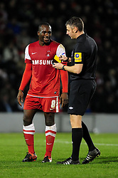 Leyton Orient's Anthony Griffith jokes with the referee, Darren Sheldrake before being sent off - Photo mandatory by-line: Dougie Allward/JMP - Tel: Mobile: 07966 386802 09/01/2013 - SPORT - FOOTBALL - Matchroom Stadium - London -  Leyton Orient v Yeovil Town - Johnstone's Paint Trophy Southern area semi-final.