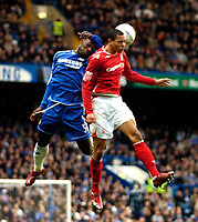 Photo: Ed Godden/Sportsbeat Images.<br /> Chelsea v Nottingham Forest. The FA Cup. 28/01/2007.<br /> Chelsea's Geremi (L) and Nathan Tyson colide in mid-air.