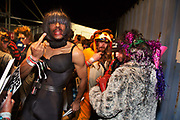 Glastonbury Festival, 2015. Shangri La is a festival of contemporary performing arts held each year within Glastonbury Festival. The theme for the 2015 Shangri La was Protest. Performers backstage on the Hell stage.