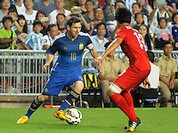 Lionel Messi of Argentina, left, challenges Cheung Kin-fung of Hong Kong during a friendly football match in Hong Kong, China, 14 October 2014.<br /> <br /> Lionel Messi needed just six minutes to make his mark in Argentina's 7-0 rout of Hong Kong in a friendly at Hong Kong Stadium on Tuesday (14 October 2014). The Barcelona star Messi scored twice after going on as a substitute for the last 30 minutes of the game to celebrate the 100th anniversary of the Hong Kong Football Association. Napoli striker Gonzalo Higuain and Benfica's Nicolas Gaitan also scored two goals each after Sevilla's Ever Banega had opened scoring in the 19th minute.