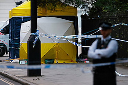 © Licensed to London News Pictures. 04/08/2016. London, UK. Forensic police officers investigate a mass stabbing incident, which left one woman dead and up to six people injured outside the Imperial Hotel in Russell Square, London. Photo credit: Tolga Akmen/LNP