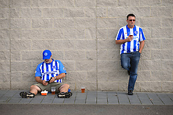 24 September 2017 -  Premier League - Brighton v Newcastle United - Brighton fans propped up against a wall drinking a pint - Photo: Marc Atkins/Offside