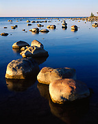 Boulders and limestone concretions in shallow water of Lake Huron at Kettle Point, Ontario, Canada