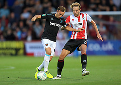 Mark Noble of West Ham United battles with Harry Pell of Cheltenham Town - Mandatory by-line: Paul Roberts/JMP - 23/08/2017 - FOOTBALL - LCI Rail Stadium - Cheltenham, England - Cheltenham Town v West Ham United - Carabao Cup