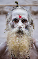 VARANASI, INDIA - CIRCA NOVEMBER 2016: Portrait of a Sadhu in Varanasi. The Sadhus or Holy Man are widely respected in India. Varanasi is the spiritual capital of India, the holiest of the seven sacred cities and with that one the most frequented places for Sadhus.