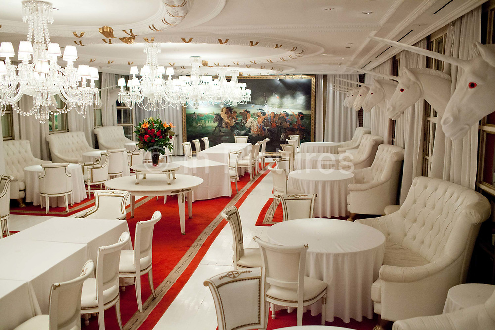 Salon dining room with unicorn busts on the walls, Faena Hotel, Buenos Aires, Federal District, Argentina.