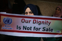 January 29, 2018 - Gaza, gaza strip, Palestine - Employees of United Nations Relief and Works Agency (UNRWA) take part in a protest against a U.S. decision to cut aid, in Gaza City January 29, 2018. (Credit Image: © Majdi Fathi/NurPhoto via ZUMA Press)