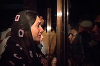 A woman believed to be a relative waits for news of Imran Khan, chairman of the Pakistan Tehreek-e-Insaf political party, who was injured falling from a forklift truck while arriving on stage at a campaign rally, at the Shaukat Khanum Memorial Cancer Hospital and Research Centre in Lahore, Pakistan, Tuesday, May 7, 2013. Pakistan is due to hold a general election on May 11, the first transition of power between democratically elected governments.