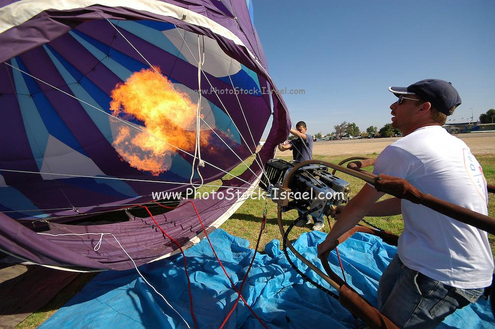 Ground crew preparing a hot air balloon before takeoff