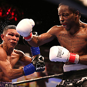 WINTER PARK, FL - AUGUST 02: Rau'shee Warren (R) lands a right cross to the face of Juan Carlos Payano during the Premier Boxing Champions on Bounce TV boxing match at Full Sail University - Ebbs Auditorium on August 2, 2015 in Winter Park, Florida. Payano won the bout and retained his WBA and IBO  bantamweight title. (Photo by Alex Menendez/Getty Images) *** Local Caption *** Juan Carlos Payano; Rau'shee Warren