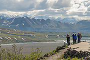 Visitors take in the view of the the Alaska Range, Denali and the McKinley River from the Eielson Visitors Center in Denali National Park Alaska. Denali National Park and Preserve encompasses 6 million acres of Alaska's interior wilderness.Denali National Park and Preserve encompasses 6 million acres of Alaska's interior wilderness.