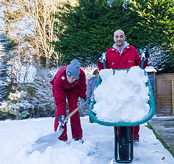 Tunbridge Wells, December 16 2017. Winner of the TK Maxx White Christmas promotion enjoy a day of fun in the snow, after aunt Helen Haggertay found one of the 'snow globes' in TK Maxx in Tunbridge Wells and gifted it to her sister Louise and niece Sofia Migliaccio. An exciting day ensued after several tons of snow were delivered BY TK Maxx and friends arrived to enjoy the day. PICTURED The TK Maxx snow team deliver a white Christmas: