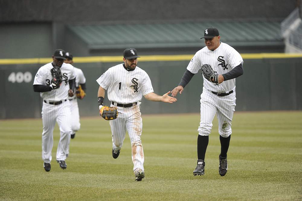 CHICAGO - APRIL 03:  Adam Eaton #1of the Chicago White Sox celebrates with teammates after making a spectacular catch against the Kansas City Royals on April 3, 2014 at U.S. Cellular Field in Chicago, Illinois.  (Photo by Ron Vesely)