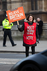 © Licensed to London News Pictures. 11/01/2019. London, UK.  A Brexit supporter waves a placard at a passing car whilst demonstrting opposite the Houses of Parliament in Westminster. Photo credit: Vickie Flores/LNP