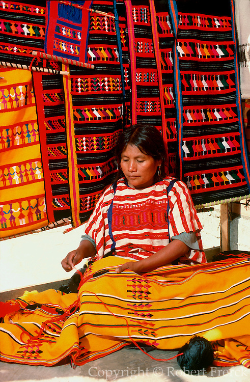 MEXICO, CRAFTS Zapotec Indian weaver, at the city market in Oaxaca