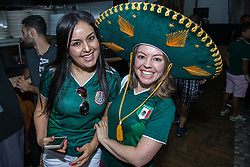 July 2, 2018 - FL, USA - Mexico fans Jasmin Rey, left, and Chantal Osorio, wearing a Mexican sombrero, react during the FIFA World Cup Round of 16 knockout stage watch party featuring Brazil versus Mexico at Vares in Brickell on Monday, July 2, 2018. (Credit Image: © Sam Navarro/TNS via ZUMA Wire)