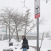 Carl Ciupi of Wakefield, MA waits patiently for the southbound MBTA bus on Main Street in Wakefield, during a heavy snowstorm