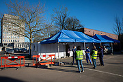 Volunteers and medical staff ready to receive patient at a drive through medical centre for the COVID-19 AstraZeneca Oxford vaccine in a car park of Folkestone council offices on Saturday the 27th of February 2021, Folkestone, Kent, United Kingdom.