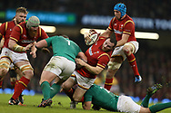 Ken Owens of Wales © is stopped by the Irish defence. RBS Six Nations 2017 international rugby, Wales v Ireland at the Principality Stadium in Cardiff , South Wales on Friday 10th March 2017.  pic by Andrew Orchard, Andrew Orchard sports photography
