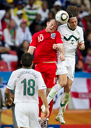 Wayne Rooney of England vs Marko Suler of Slovenia during the 2010 FIFA World Cup South Africa Group C Third Round match between Slovenia and England on June 23, 2010 at Nelson Mandela Bay Stadium, Port Elizabeth, South Africa.  (Photo by Vid Ponikvar / Sportida)