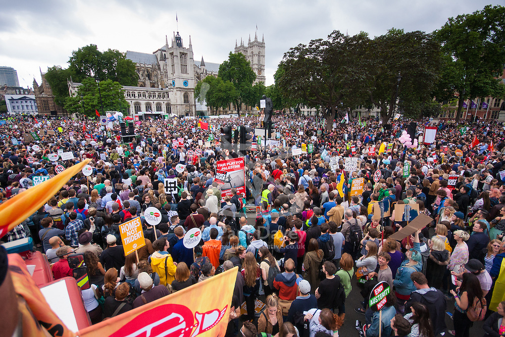 London, June 20th 2015. Thousands of people converge on the streets of London to join the People's Assembly Against Austerity's march from the Bank of England to Parliament Square. PICTURED: Part of the vast crowd in and around Parliament square as they listen to speakers at a rally following their march.