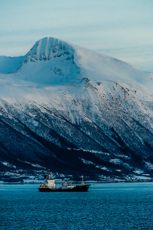 Ship sailing along the Norwegian coastline near Midsund, More og Romsdal County, between Alesund and Molde, Norway.