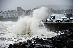 © Licensed to London News Pictures. 16/03/2019. Aberystwyth, UK. Storm Hannah brings huge waves crashing into the harbour lighthouse and sea defences on an extremely wet and windy day in Aberystwyth Wales.  Gusts of over 50mph are forecast to impact parts of the north and west of the country today as the period of very unsettled weather  continues to dominate the UK. Photo credit: Keith Morris/LNP