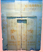 Limestone false door of KaihapFrom Saqqara, Egypt. 5th Dynasty, around 2400 BC. Kahihap was a minor official, though his titles rather grandly claim that he was 'King's Confidant' and 'Chosen Inspector Of Those Who Are In Attendance'. This false door is all that survives of his tomb-chapel at Saqqara. In addition to the normal inscriptions, the stela depicts an unusually large number of people. Either side of the couple on the central panel at the top are a row of five male and five female children, while on the jambs either side of the standing couple on the lower part of the door are six male and three female grandchildren. Below the standing figures are ten men carrying offerings, at least two of whom are 'soul priests', who would look after the rituals to be performed in the tomb.