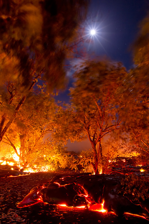 """The surreal, moonlit scene unfolds as good friend and fellow lava junkie, Gary Sleik, and I watch a lobe of lava flow down his driveway toward his home.  Knowing the inevitable is about to happen, he turns to me with tears in his eyes and says, """"I couldn't have asked for anything more than this…  a beautiful moonlit night…  a beautiful finger of pahoehoe… """"   Within a few hours, Gary's home was completely destroyed by the lava.  The irony of nature couldn't have been more apparent in that moment, because as destructive as it is, there is so much beauty in this creative force…  AND, the resiliency of the human spirit is no more evident in this as well, as Gary has returned and rebuilt his home, and enjoying life in the middle of a lava field!"""