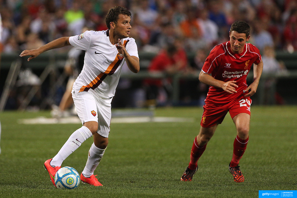 Adem Ljajic, (left), AS Roma, challenged by Joe Allen, Liverpool, in action during the Liverpool Vs AS Roma friendly pre season football match at Fenway Park, Boston. USA. 23rd July 2014. Photo Tim Clayton